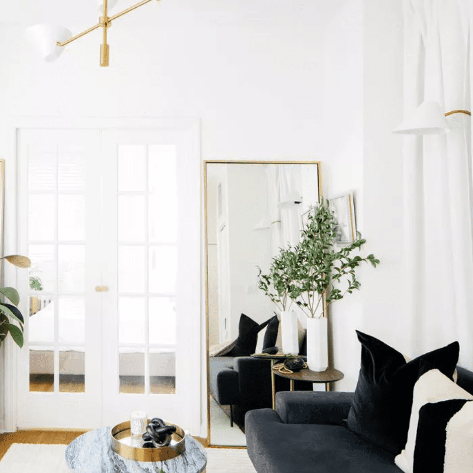 Modern living room with large, leaning mirror