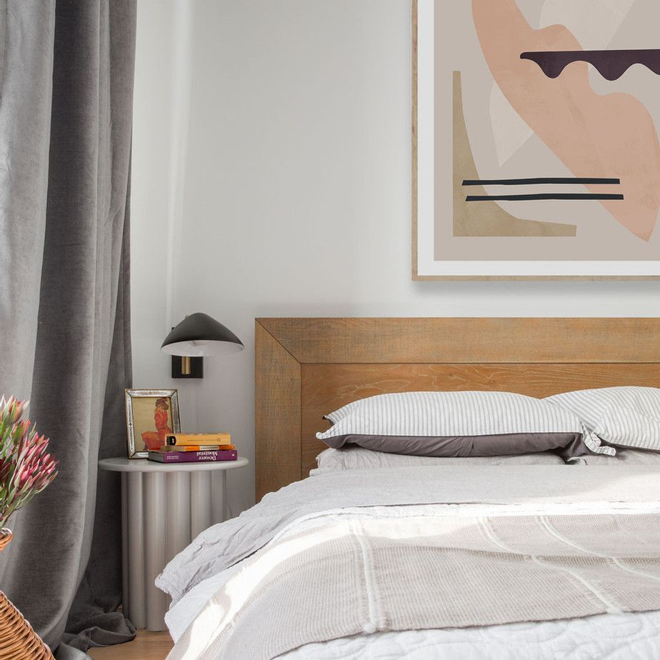 Modern bedroom with gray curtains, bedding, and accents