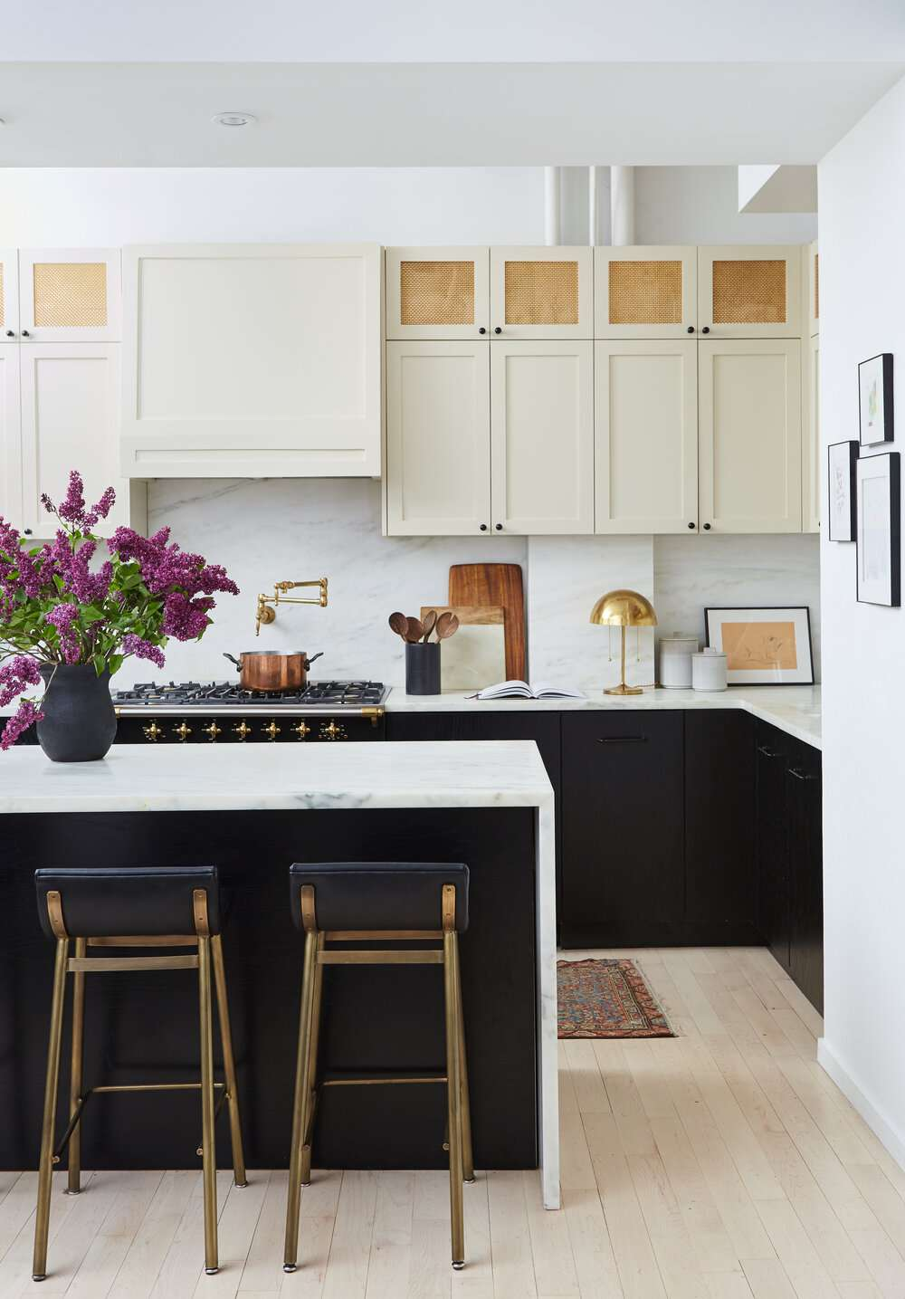 A kitchen decorated with rustic cooking utensils and some more contemporary fixtures