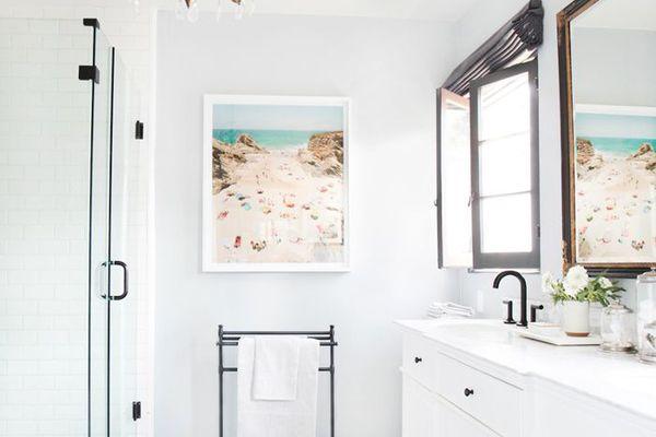 bathroom with decorative chandelier