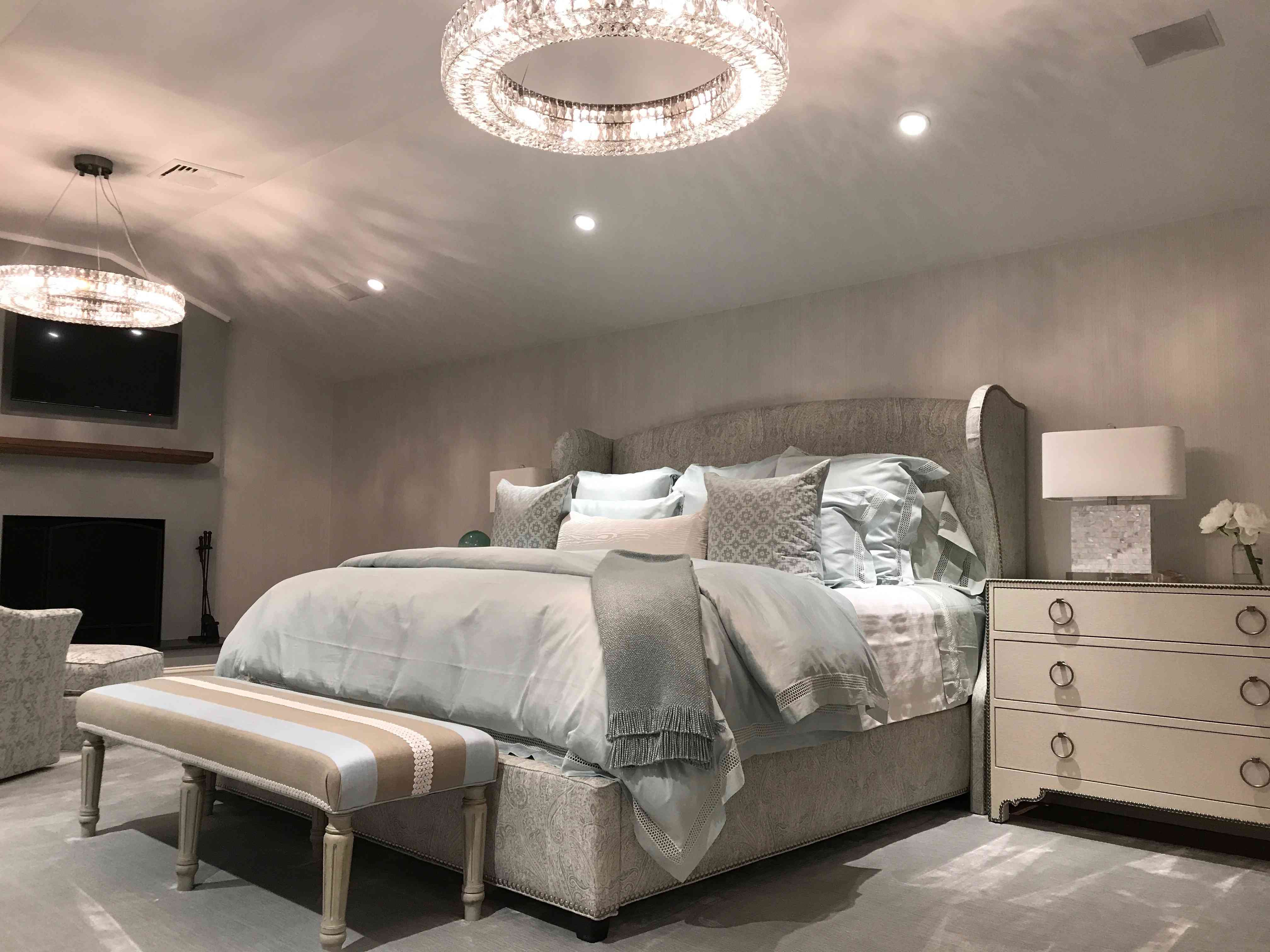 Taupe gray bedroom with crystal chandeliers