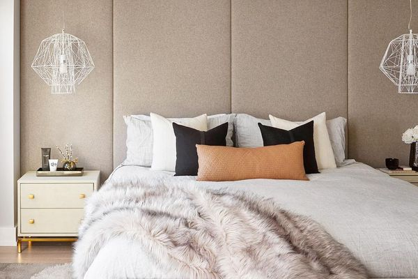 Neutral bedroom with bench at foot of bed.