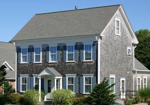what is a cape cod style house - gray cape house with siding