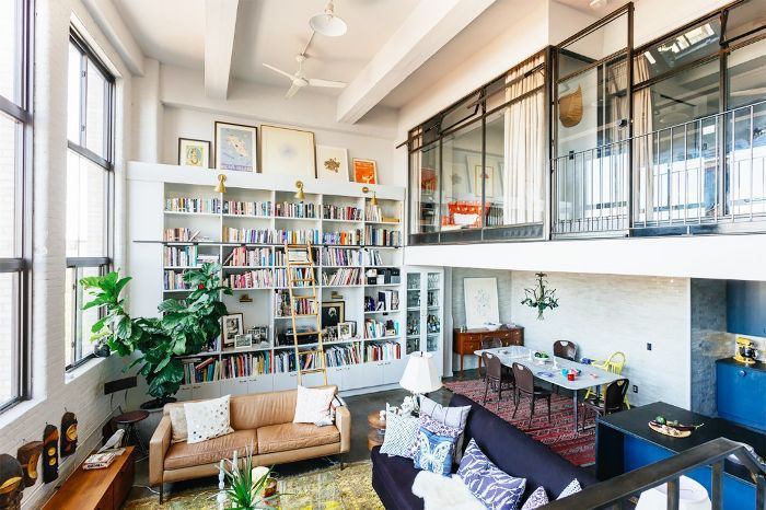 Living room defined by area rugs
