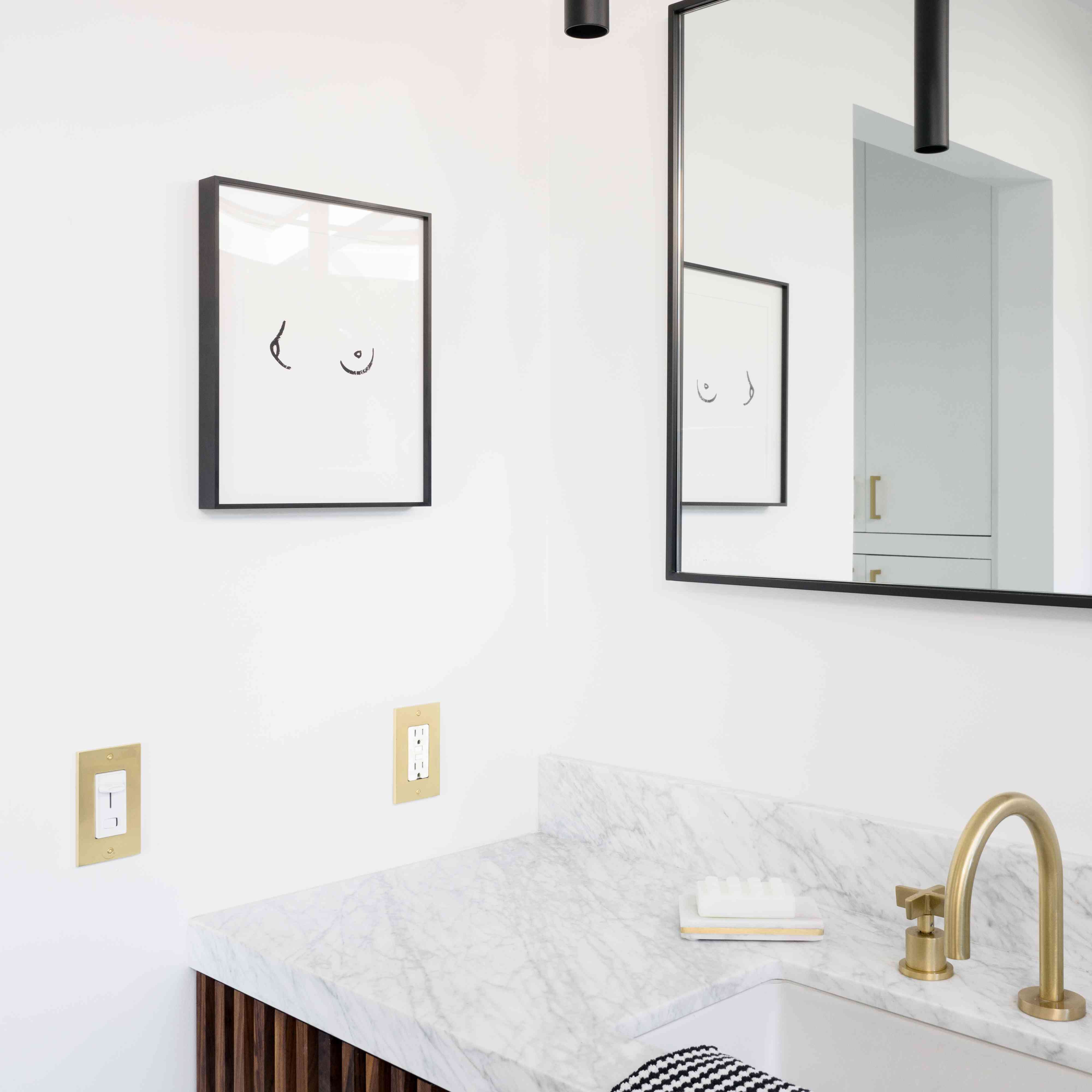 Bathroom vanity with marble countertop.