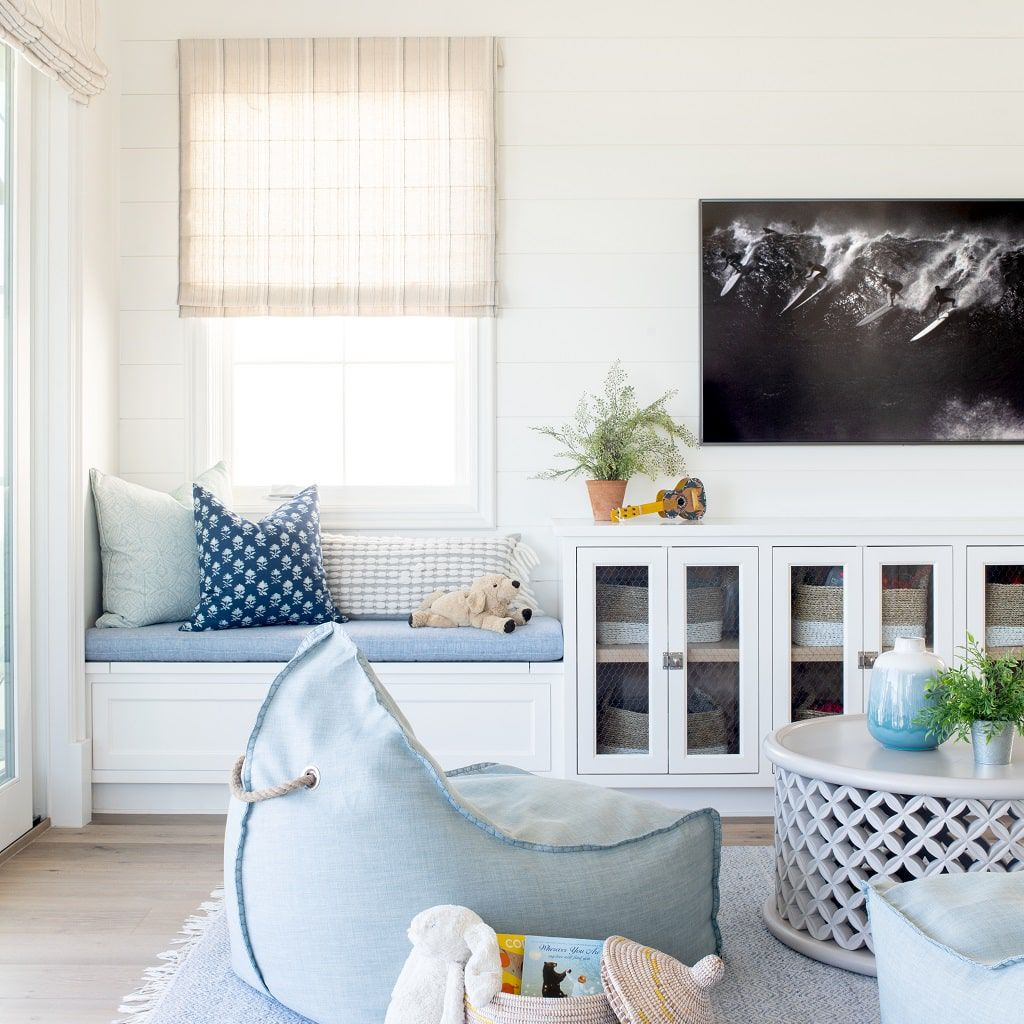 Living room with bench seat and floor pillow