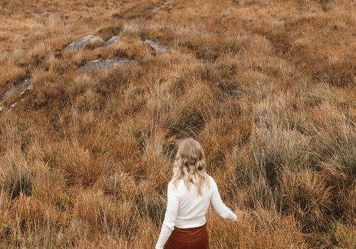Woman in grass field.
