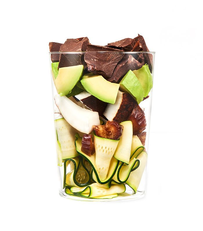 Daily Harvest smoothie cup filled with vegetables, nuts and chocolate bits