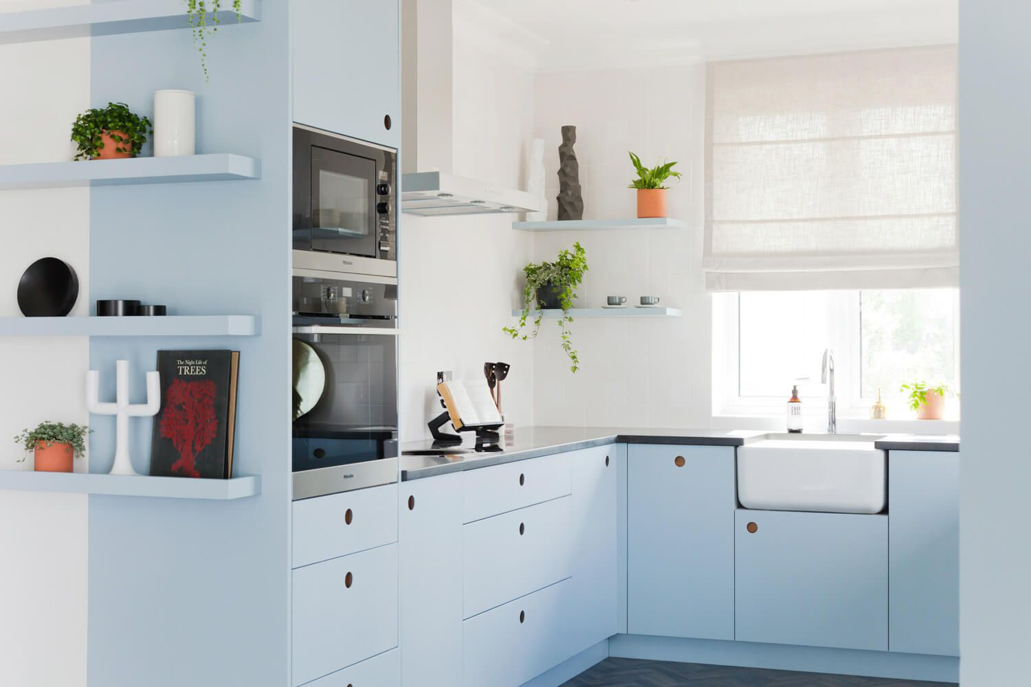 Small kitchen with baby blue cabinets.
