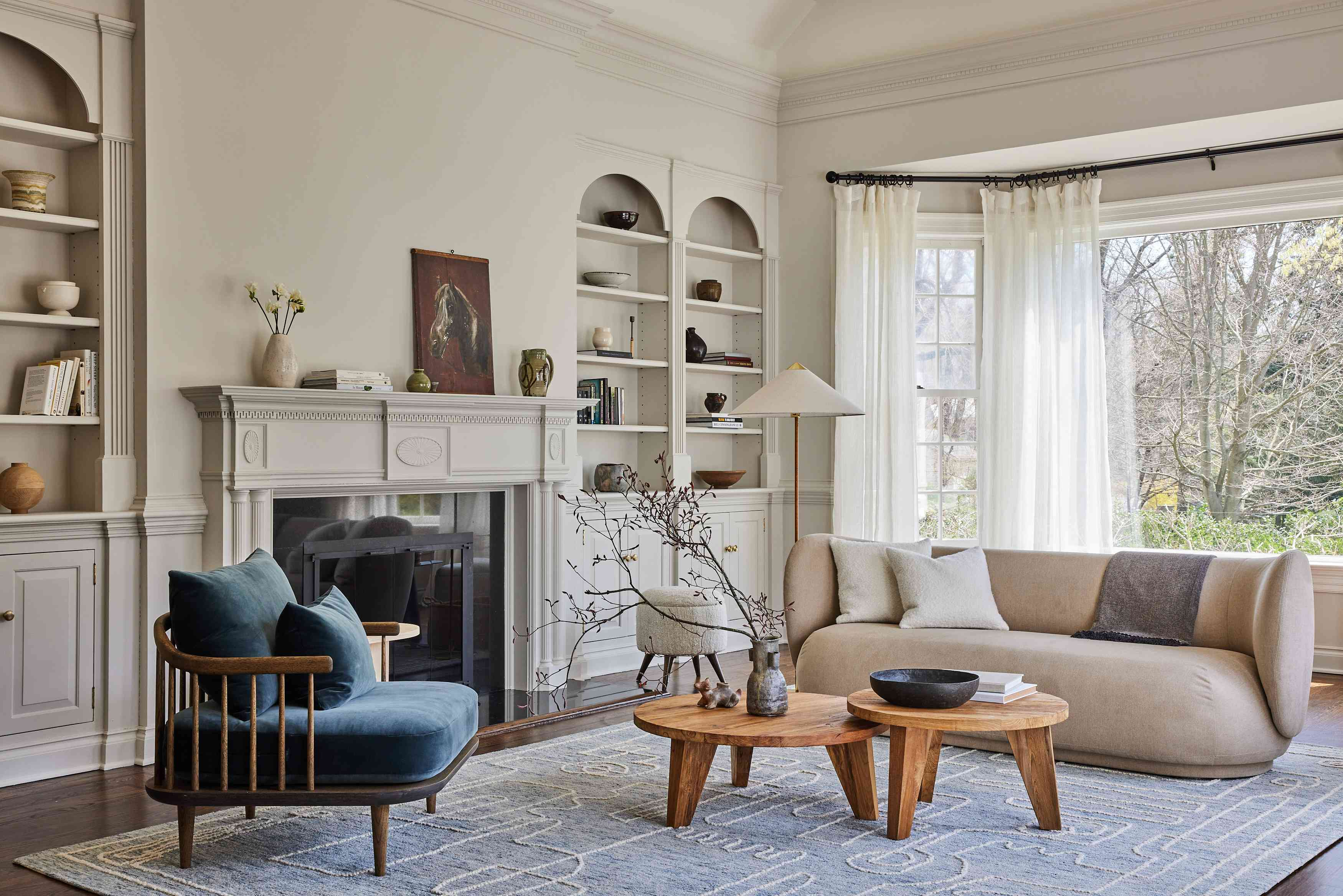 modern connecticut farmhouse home tour - living room with rounded sofa and white built-ins
