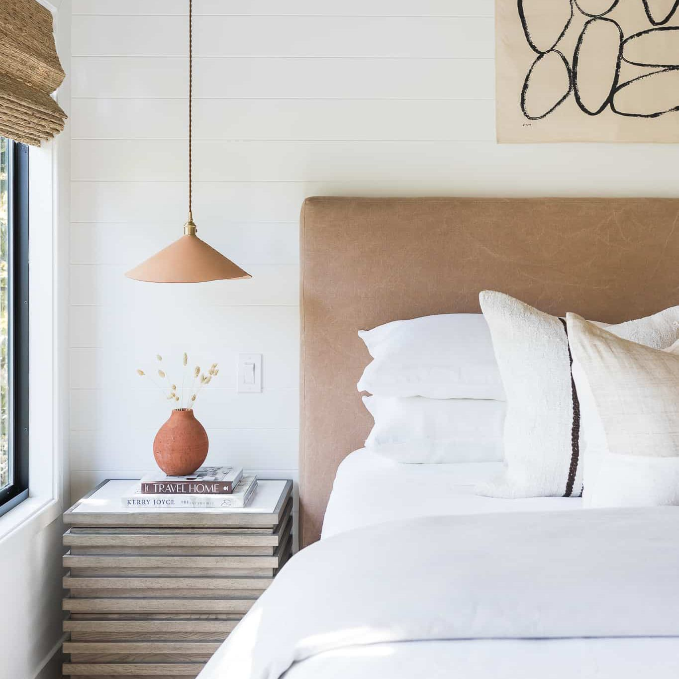 A modern bedroom with a plush leather headboard