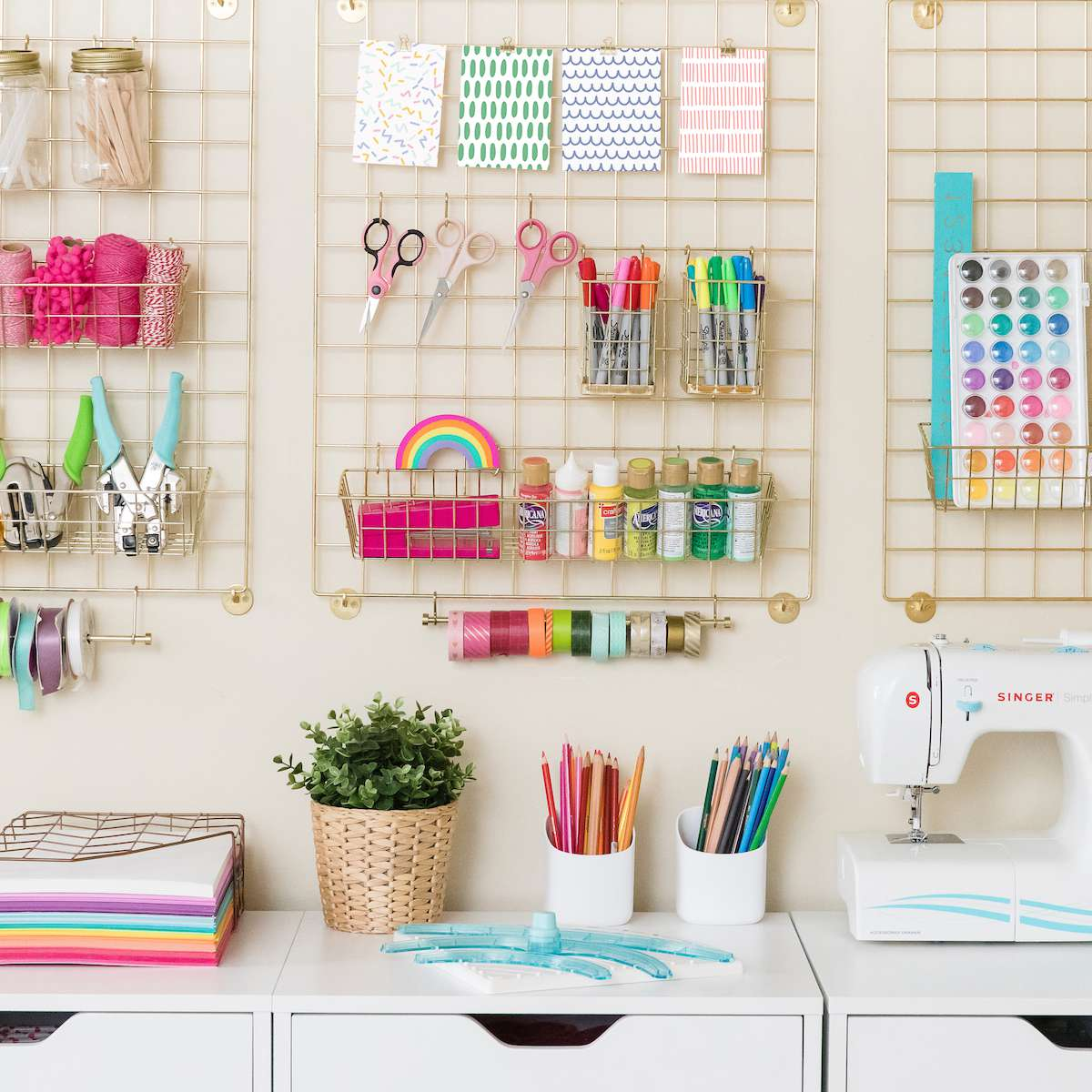 A well organized craft room filled with colorful art supplies
