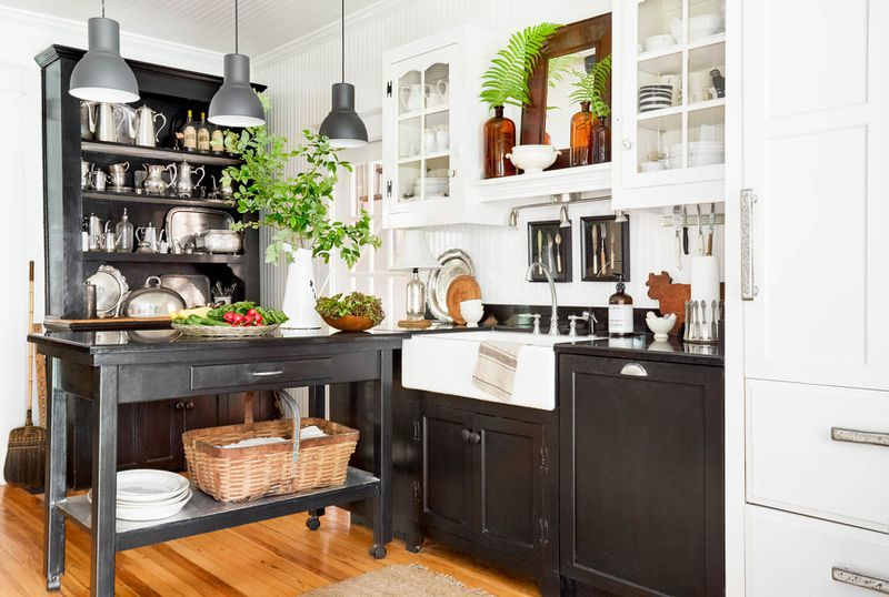 Kitchen with portable island on wheels