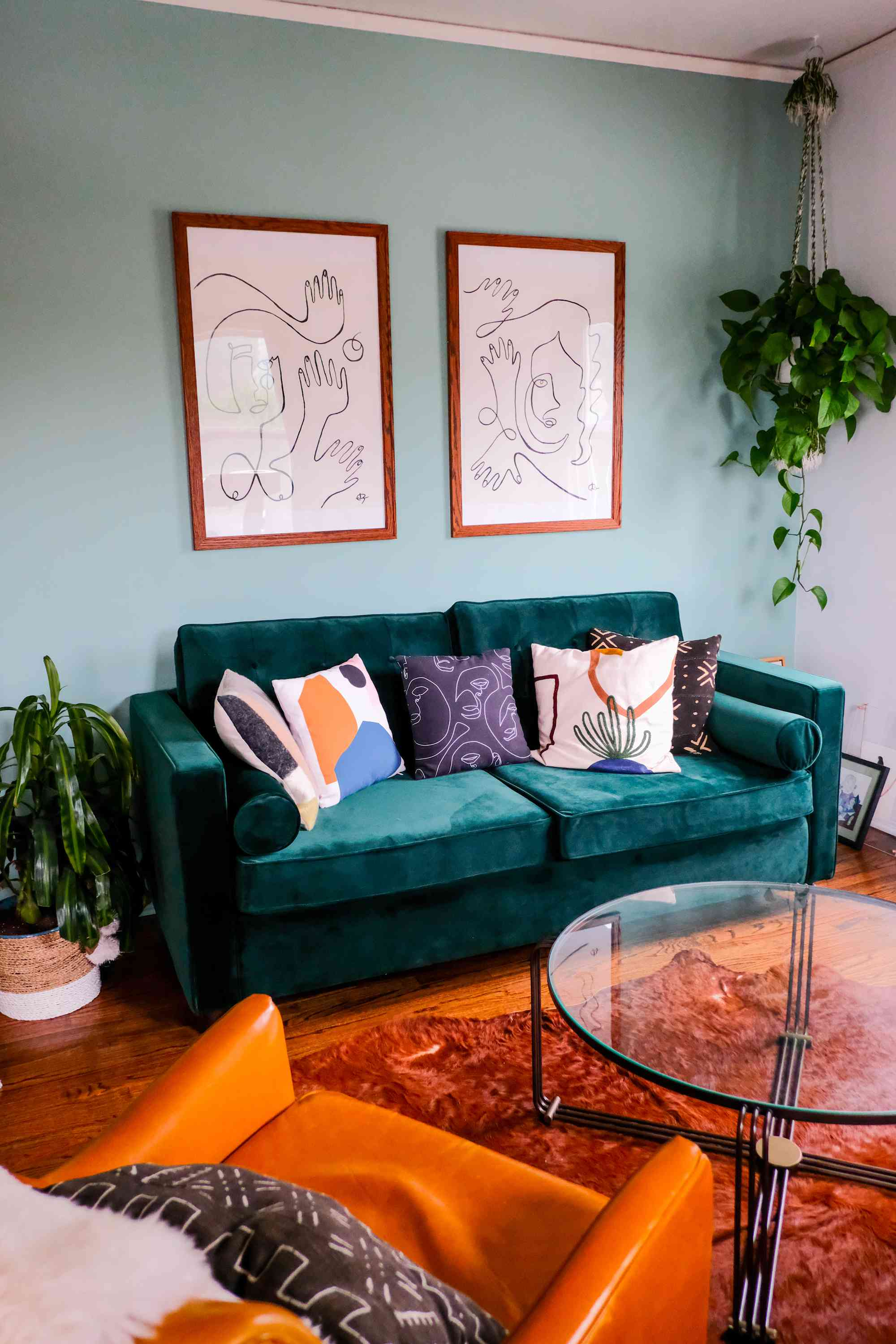 Colorful living space will teal couch.
