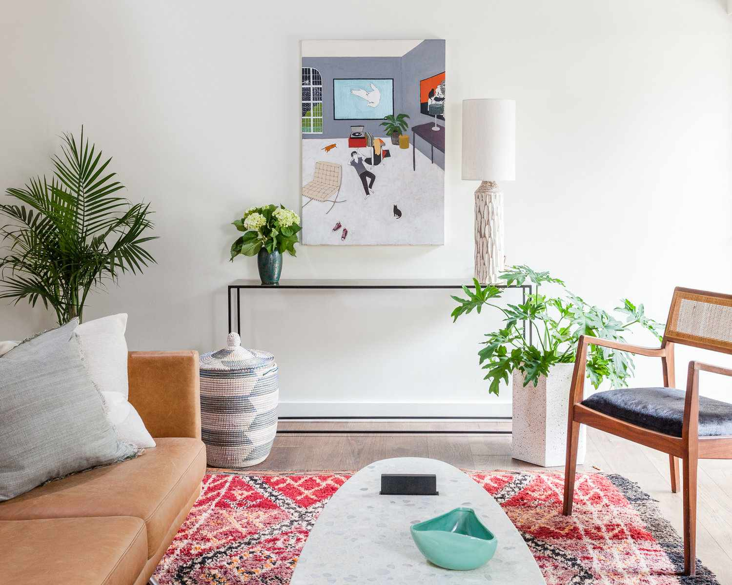 Fun console table with artwork and plants.