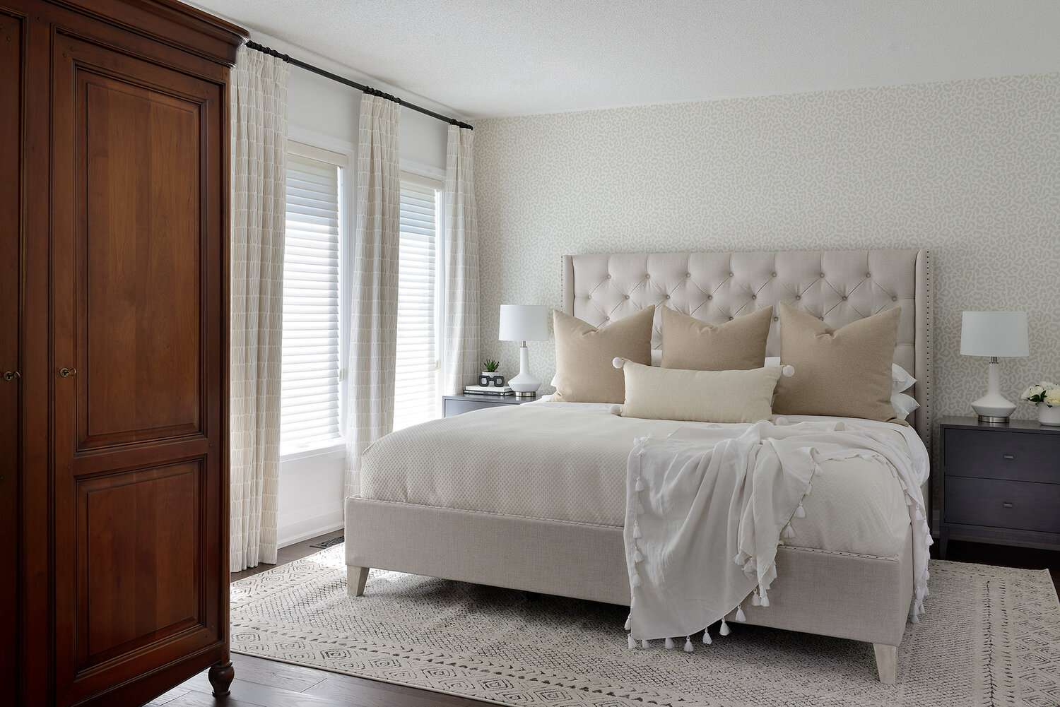 Traditional neutral bedroom with animal print wallpaper.