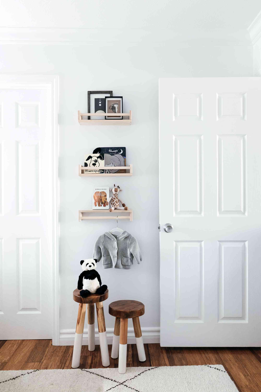 nursery using IKEA spice racks for book storage