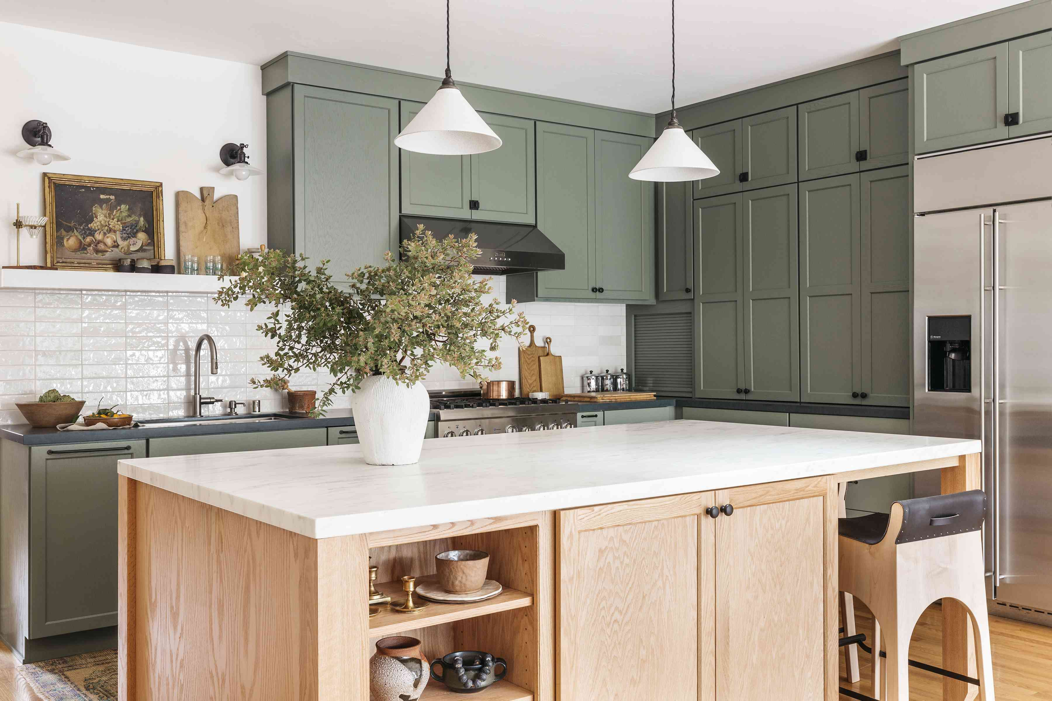 Brett Foken home tour - green kitchen with wood island with white marble countertop