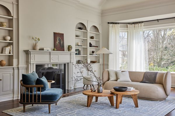 A living room filled with traditional millwork and contemporary furniture