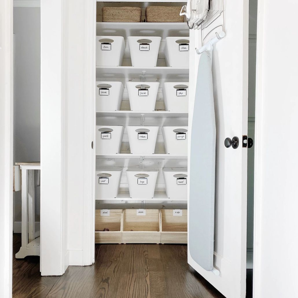 hall closet with shelves and shiplap
