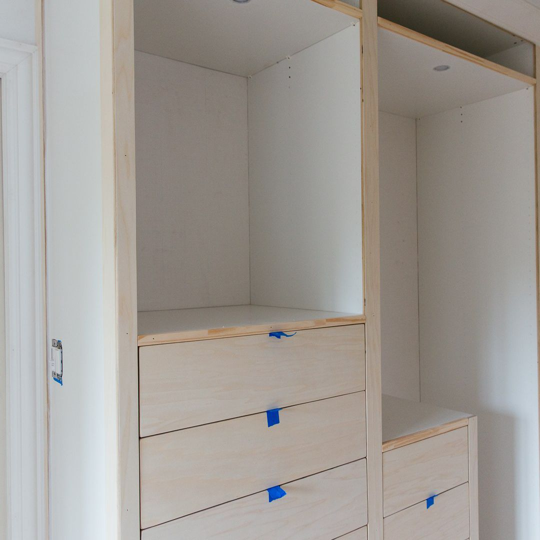 An IKEA closet with recessed lighting, in the process of being built