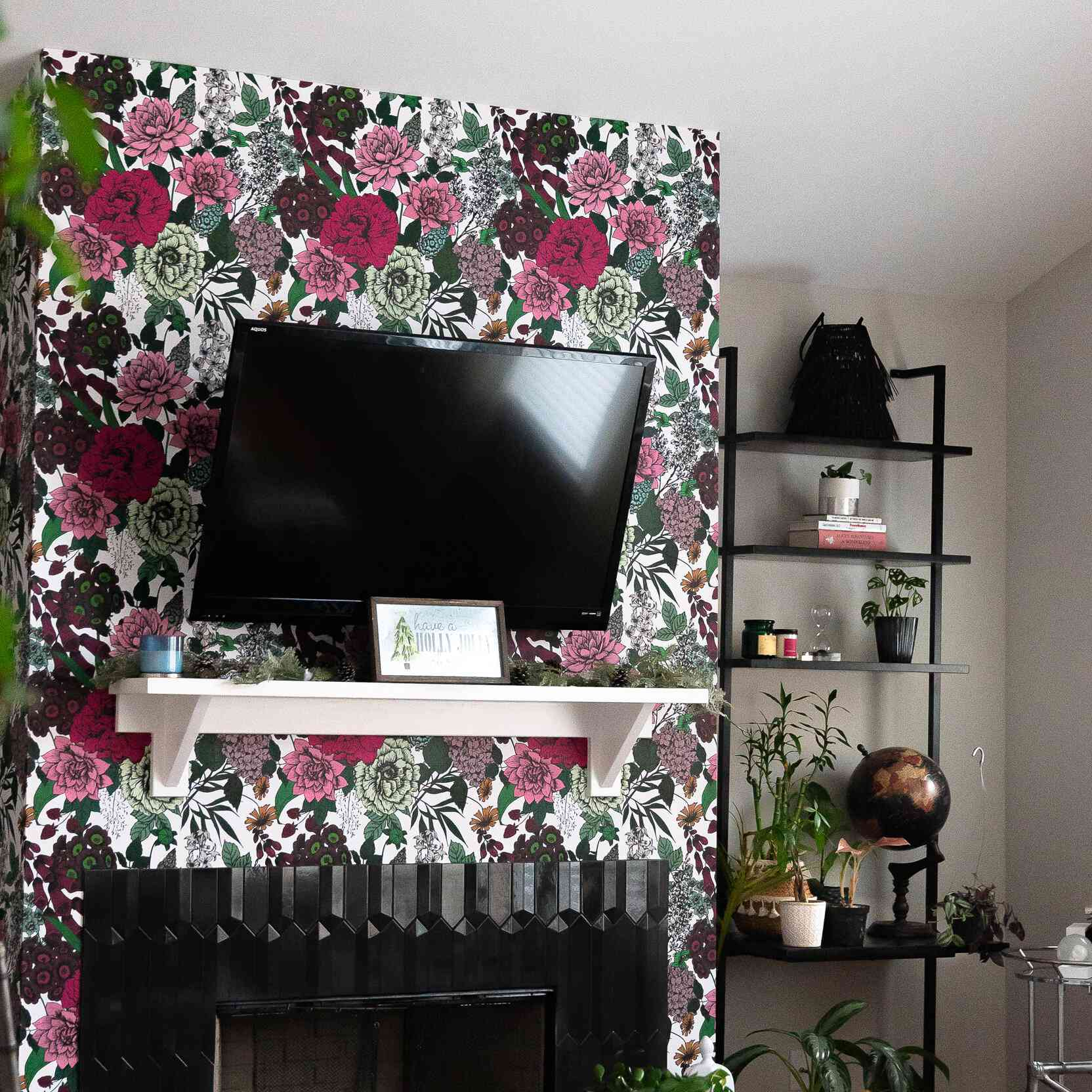 Modern fireplace wall with graphic wallpaper and geometric tiles