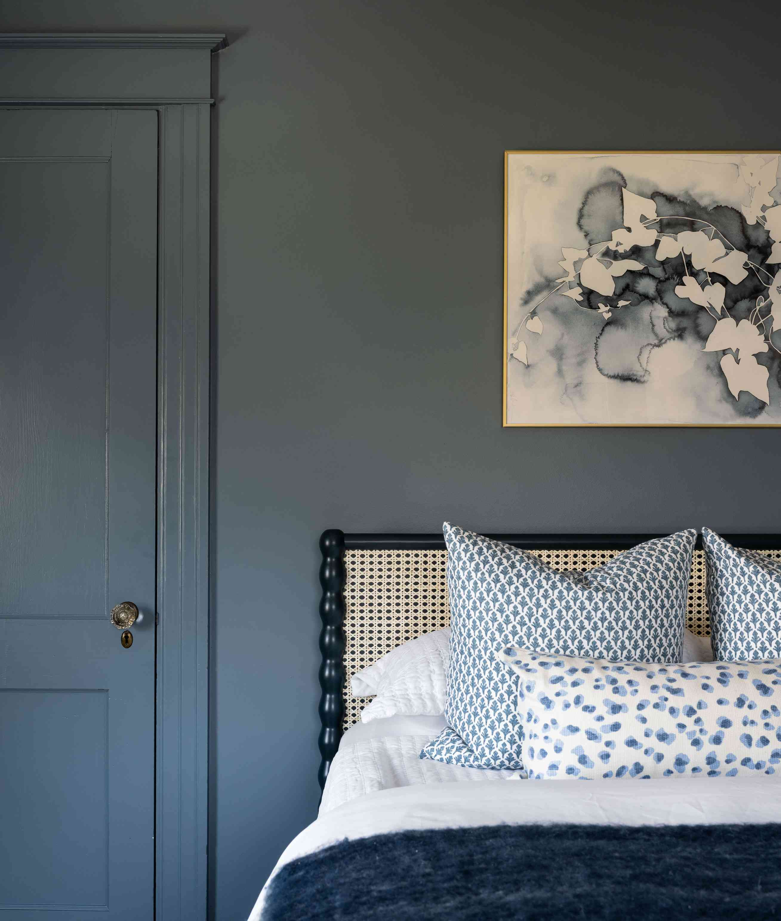 newport beach house all blue guest bedroom with rattan headboard