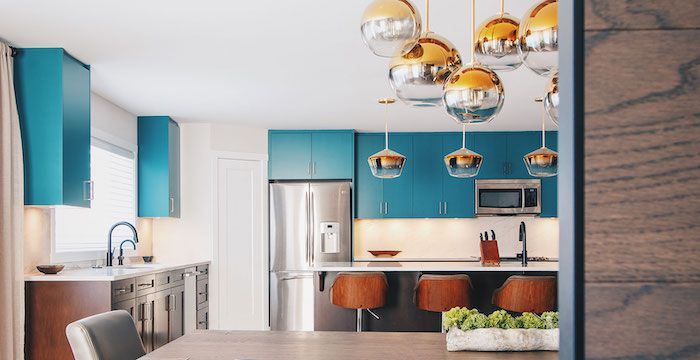 modern kitchen with bright blue upper cabinets and dark wood lower cabinets