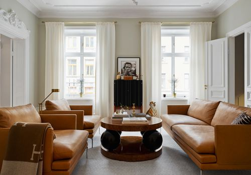 living room with leather sofa and chairs
