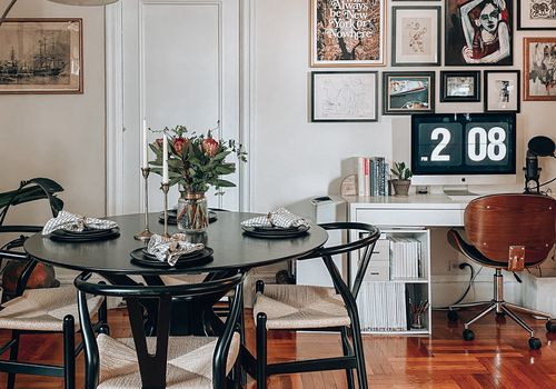 Trendy dining nook with wishbone chairs.