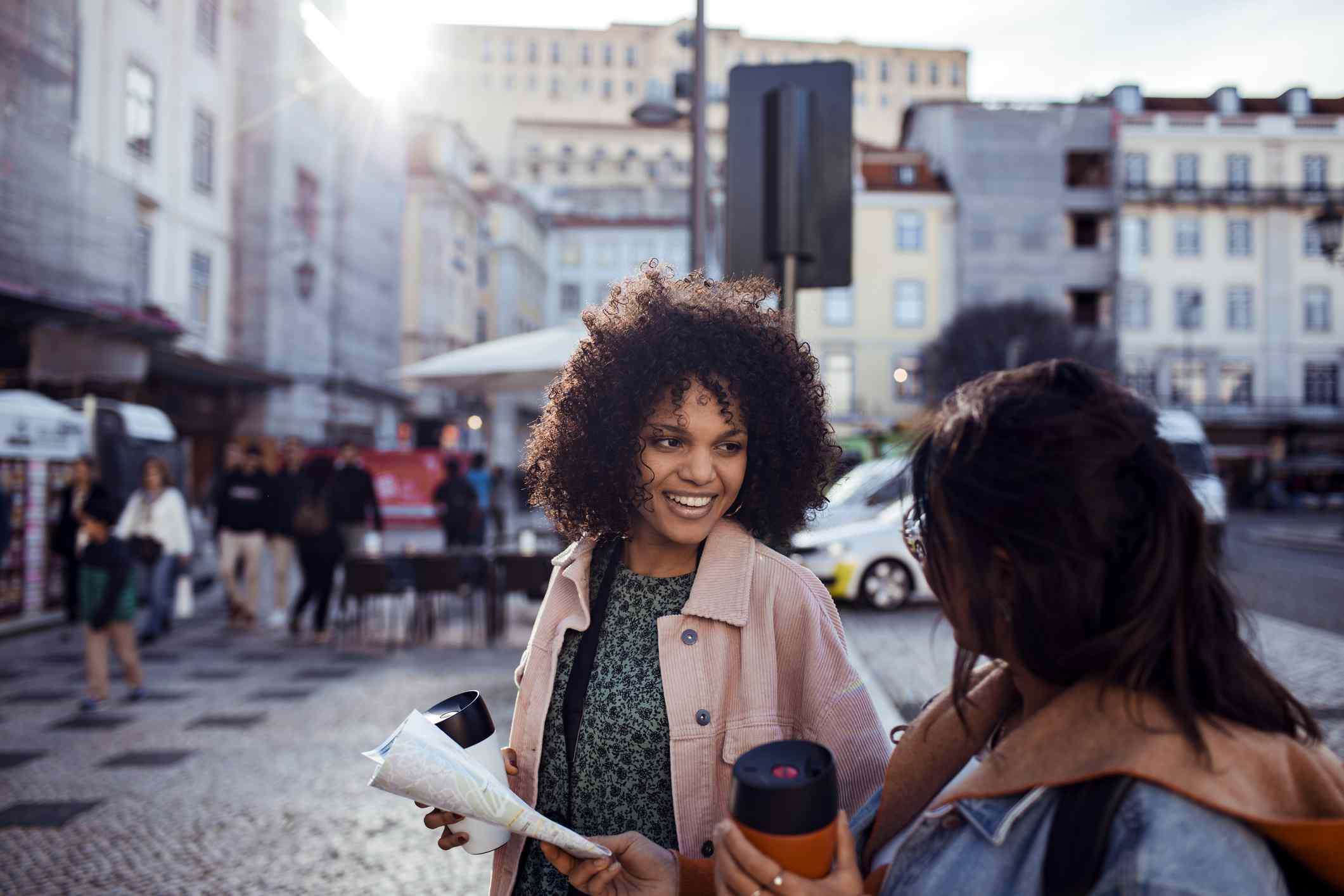 women talking on street