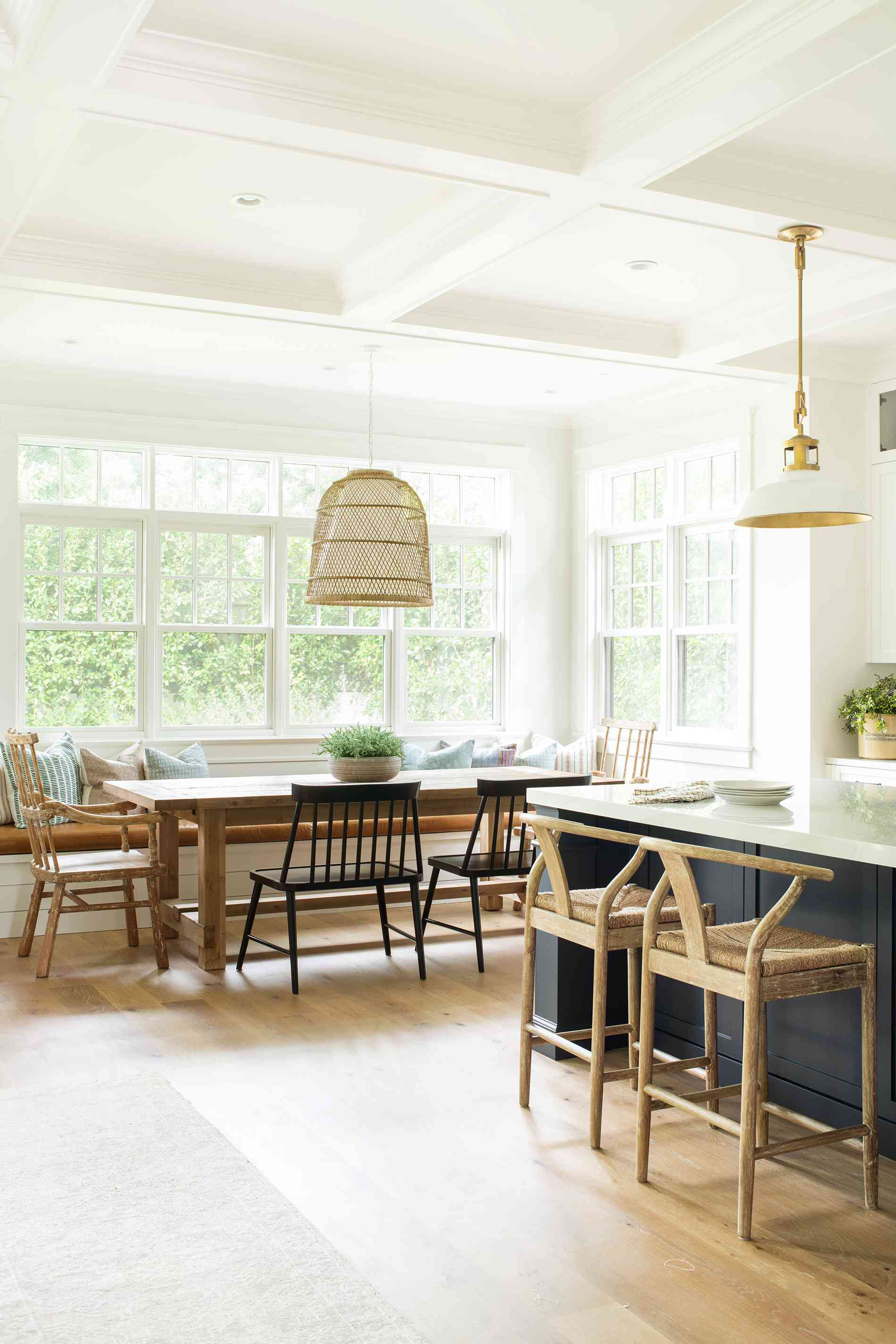 Bright kitchen view of island and table.