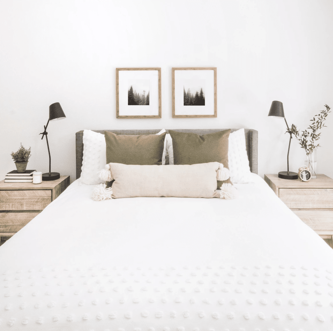 An all-white bedroom with an ivory pillow