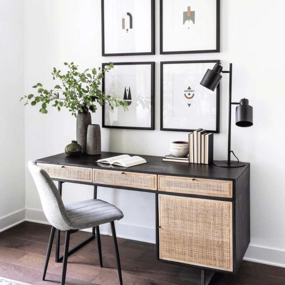 A woven cane desk adorned with sleek black and gray decor