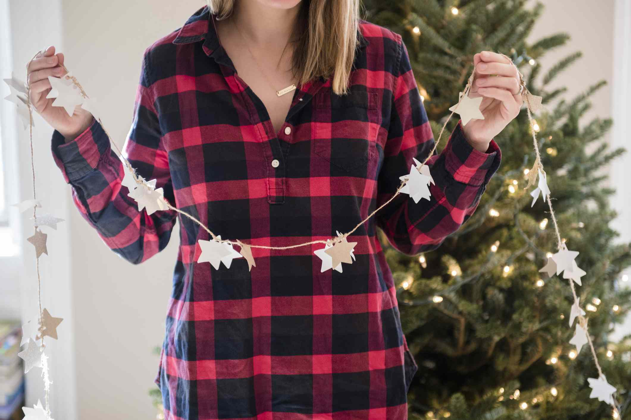 woman decorating for christmas