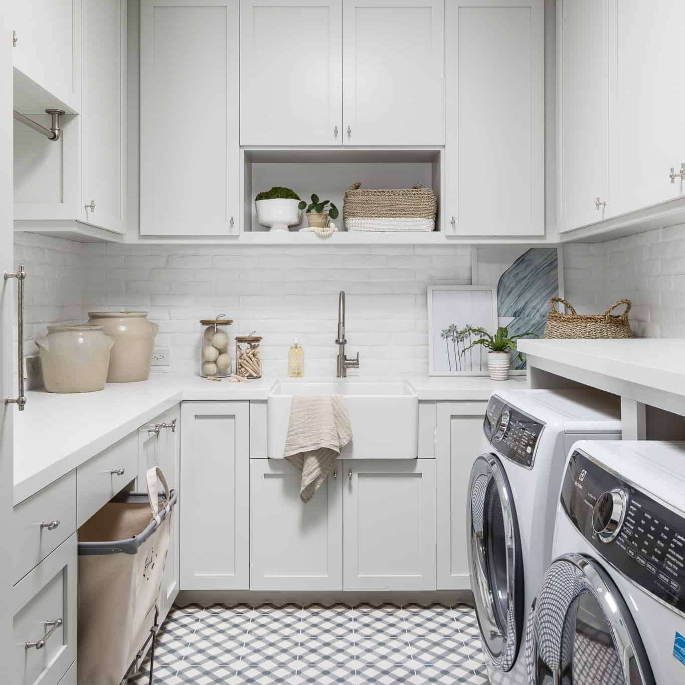 laundry room with white painted brick