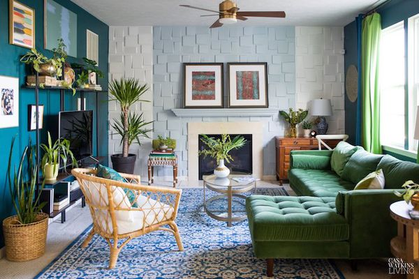 green sectional in jungle inspired living room