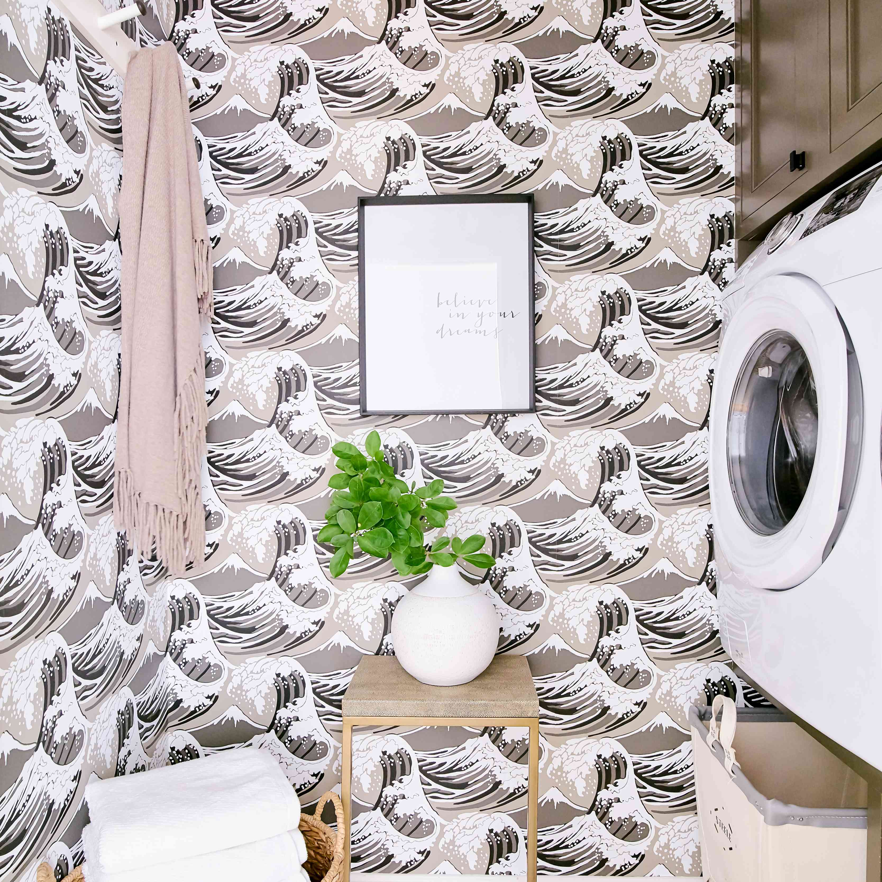Brown wave wallpaper decorating a small laundry room