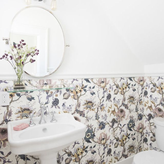 Powder room with moody purple and blue floral wainscot wallpaper