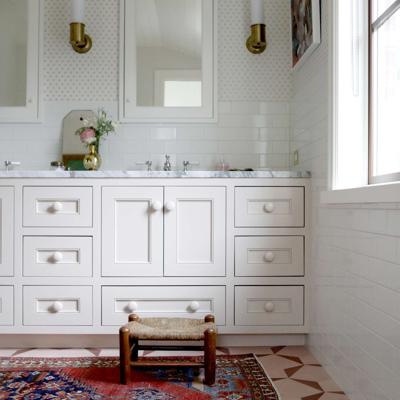 Girls bathroom with wallpaper