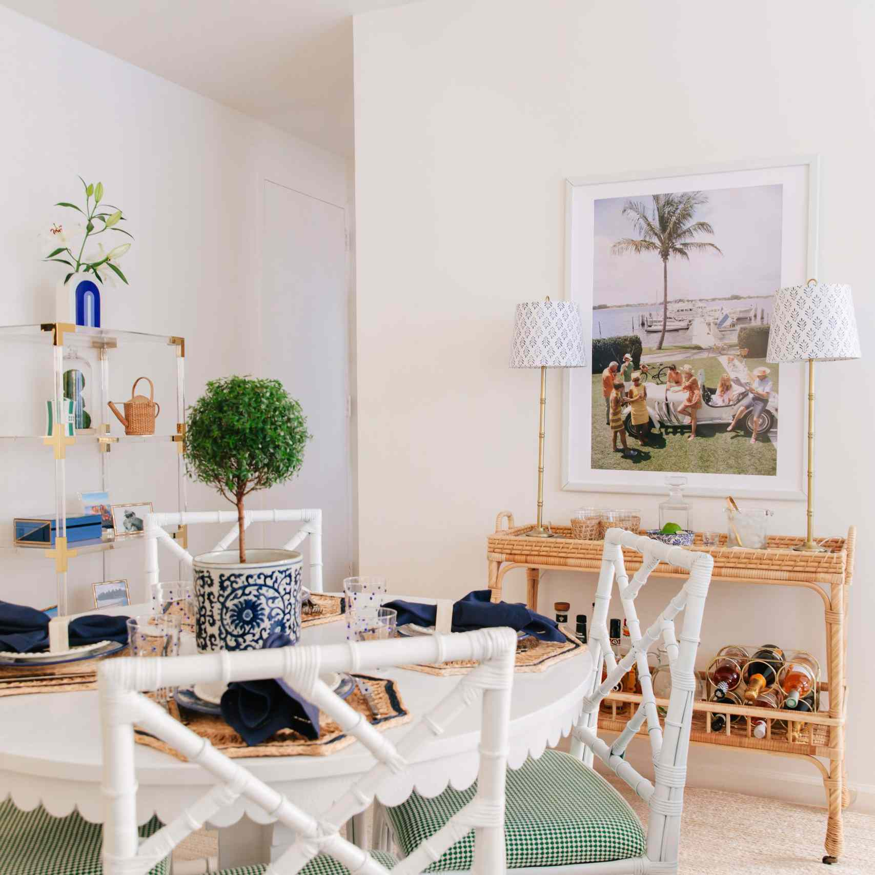 Bright coastal inspired dining room with white table.