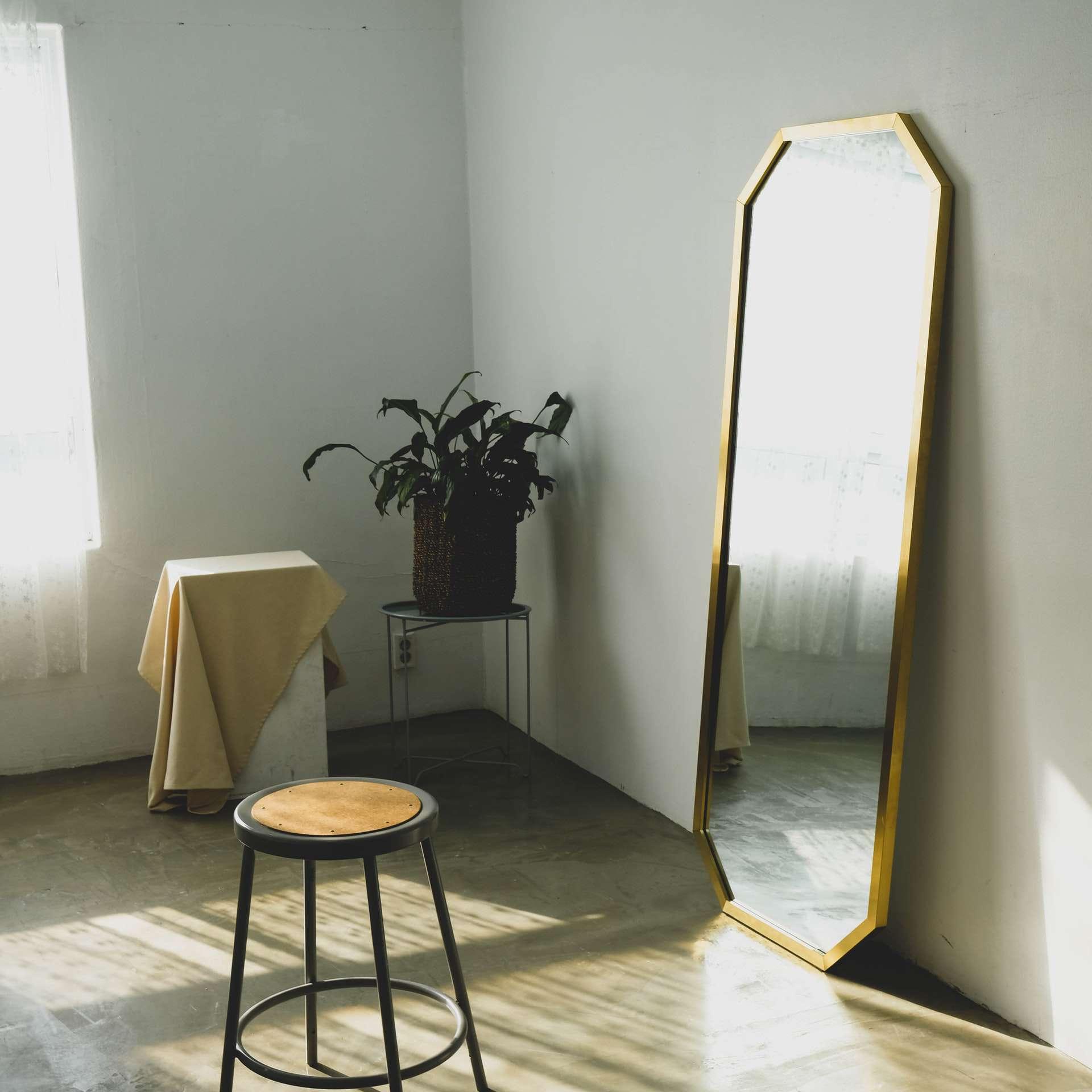 minimalist room with floor mirror