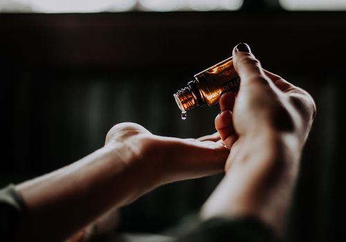 applying essential oil to hands