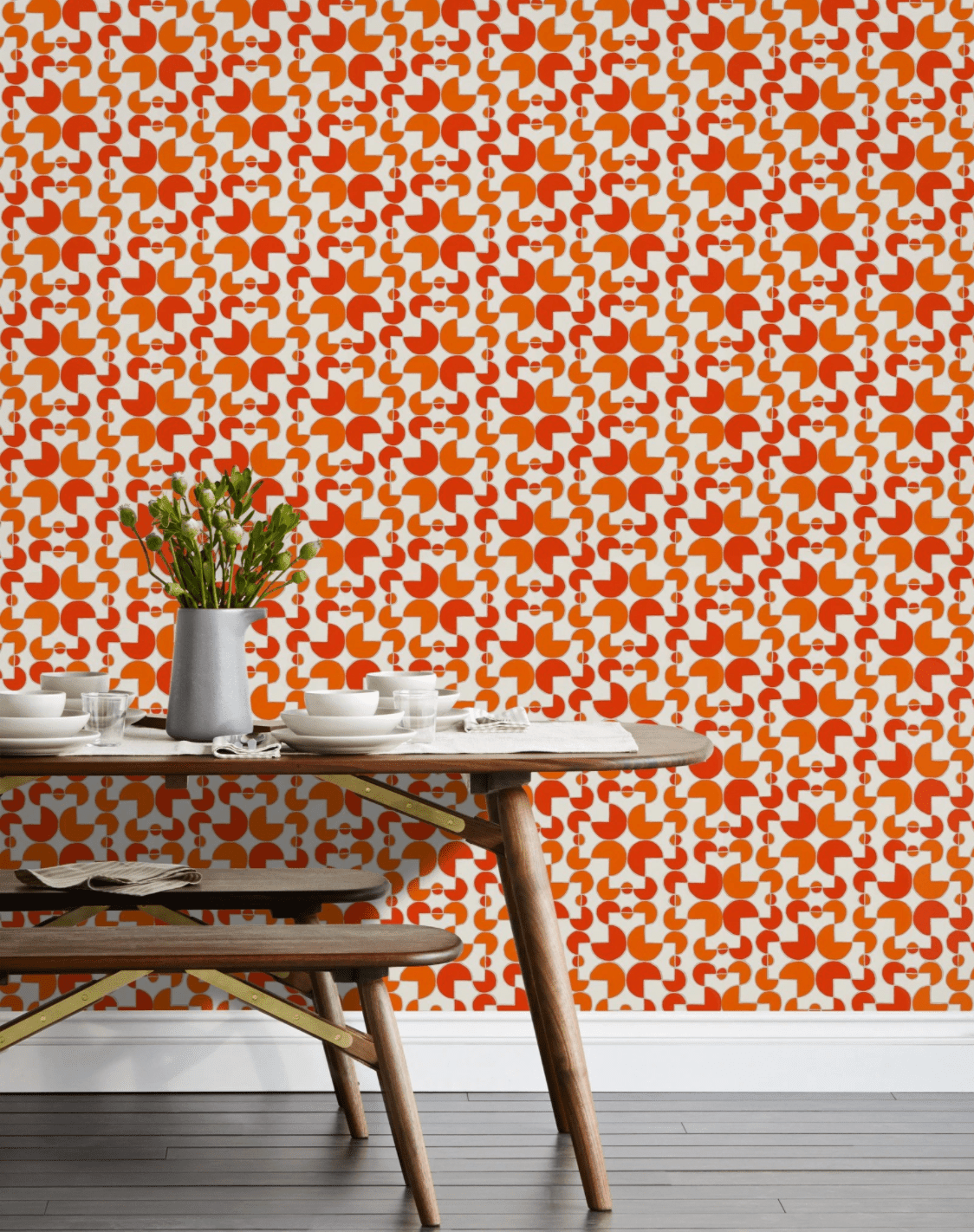 A wall covered in red and orange printed wallpaper