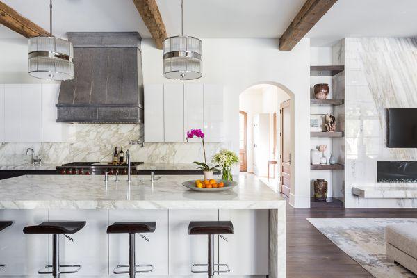 Open concept white marble kitchen.