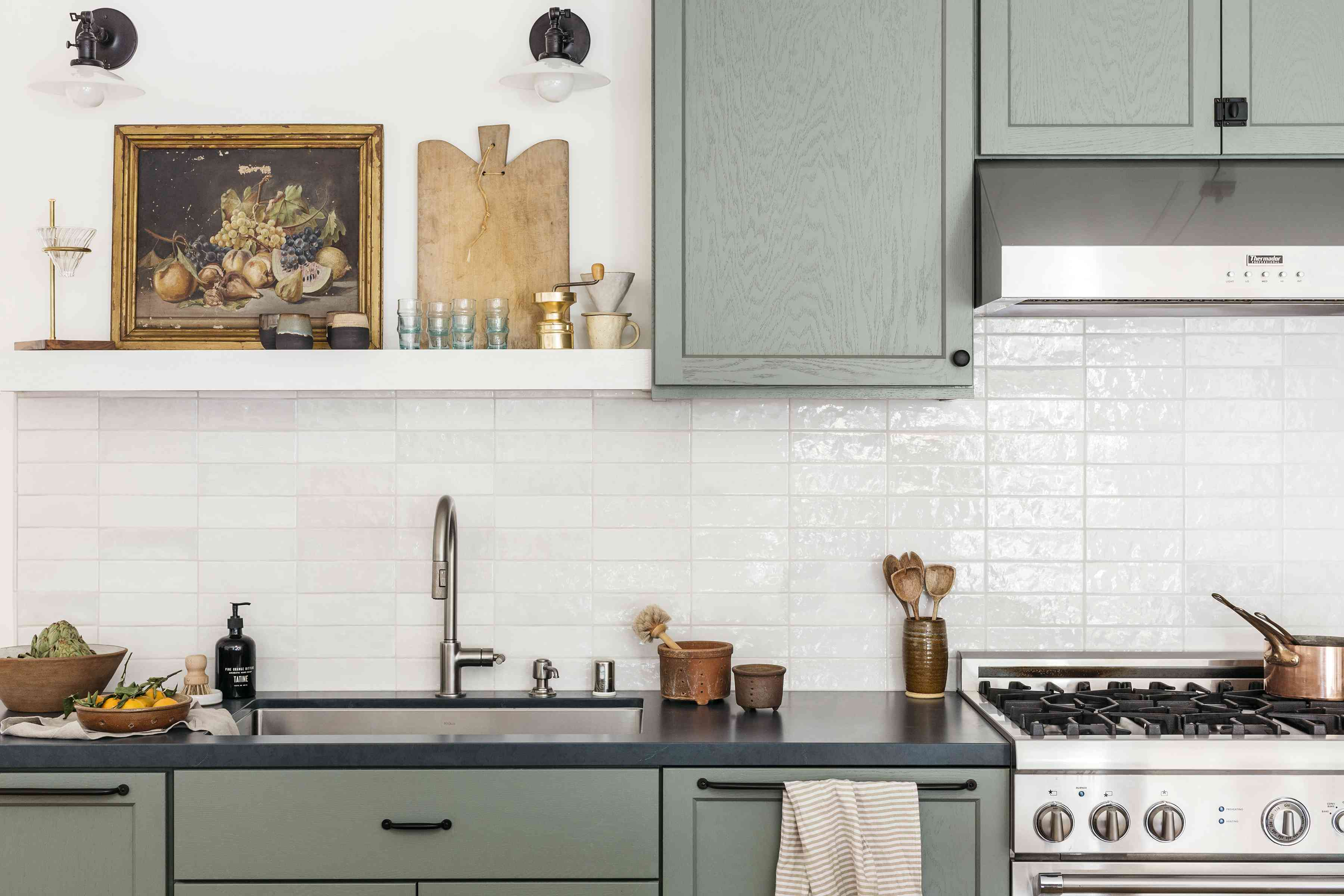 Brett Foken home tour - close-up of kitchen island with art, utensils and collectables