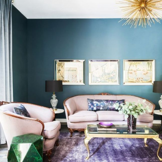 Formal sitting room with blue walls, pink furniture, and purple carpet
