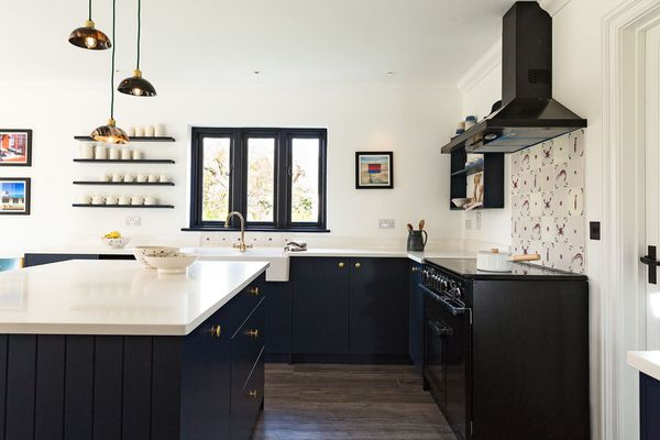 Moody navy blue kitchen with navy appliances.