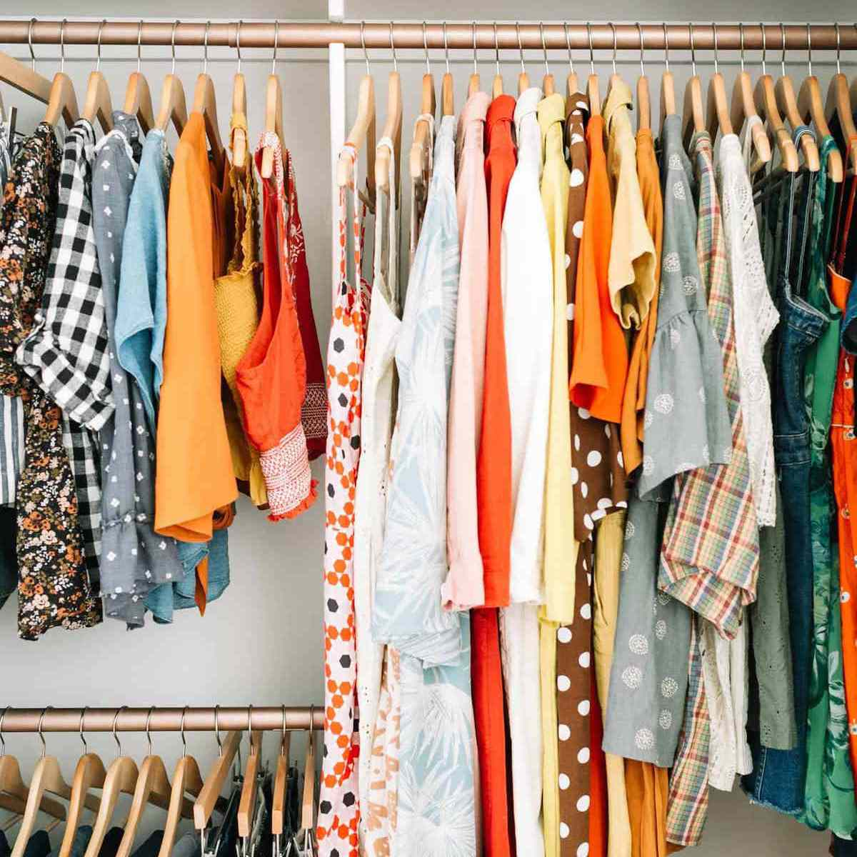 A child's closet with painted clothing rods