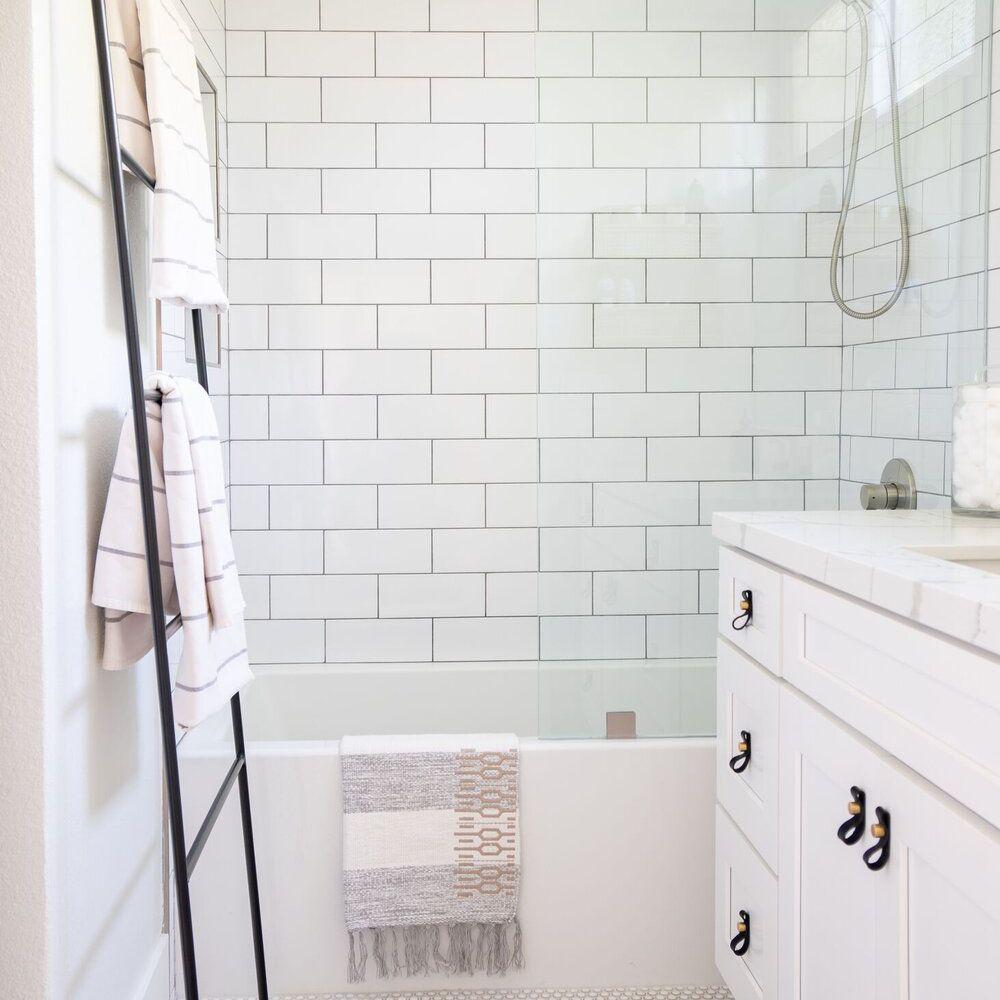 White marble and white subway tile bathroom